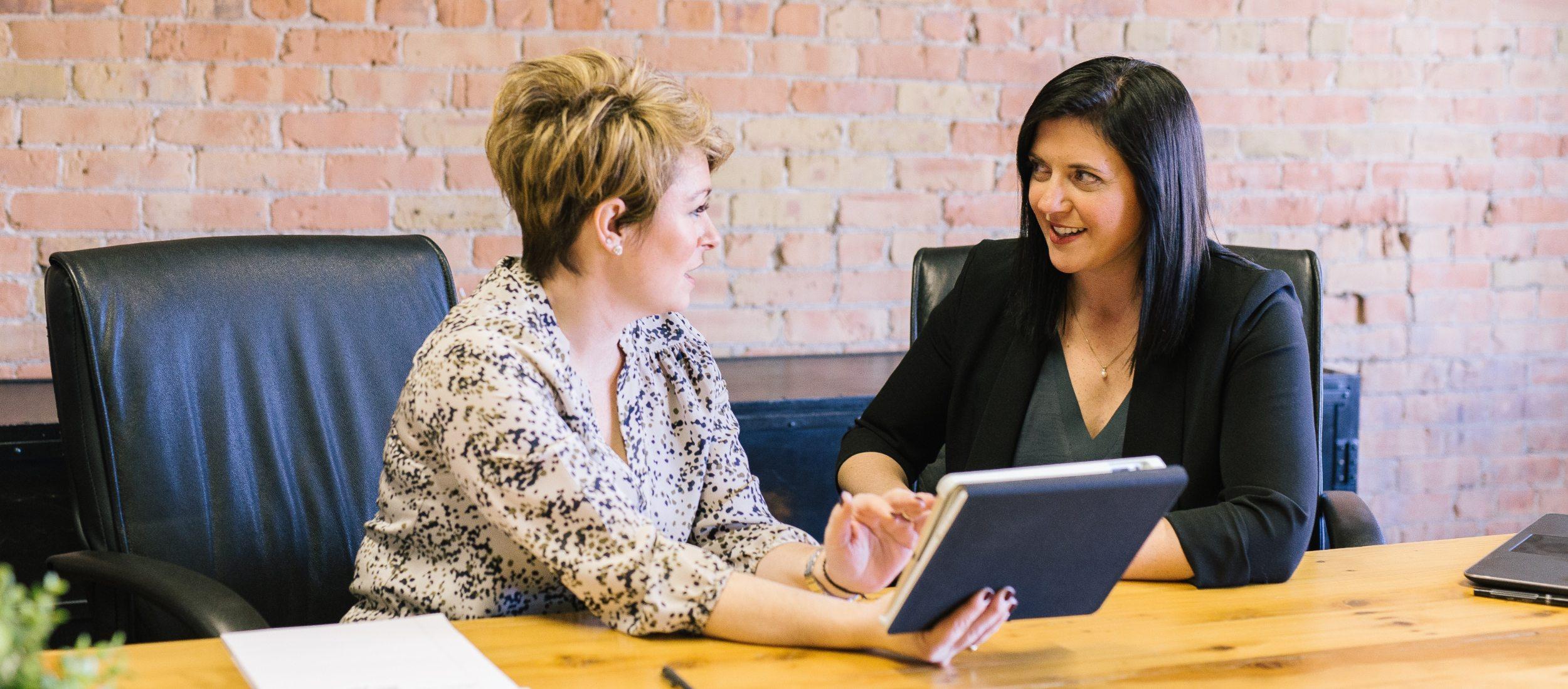 woman coaching an executive in Denver office depicting executive programs
